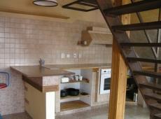 RD Malíkovice - obývací pokoj s kuchyňským koutem